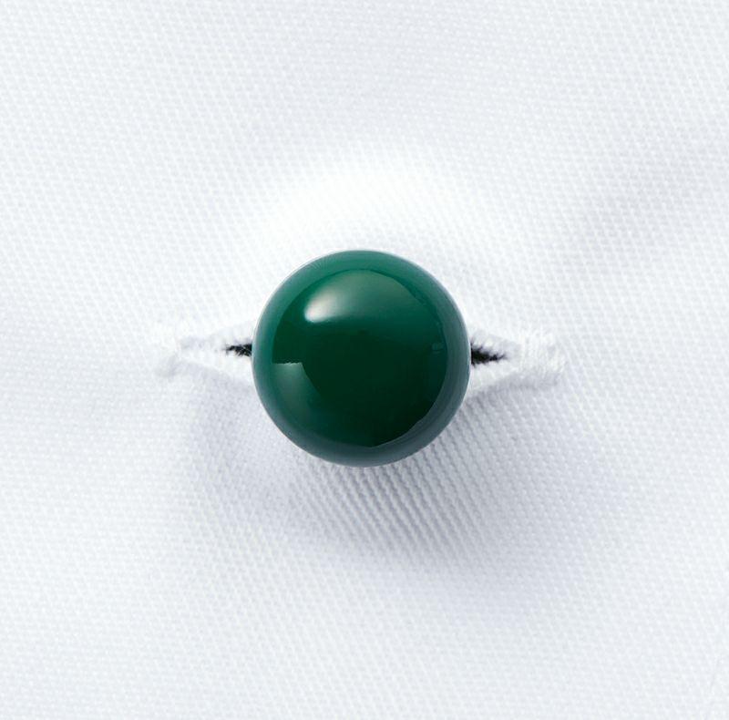クラフィッターボタンのグリーンのアップ写真です。
